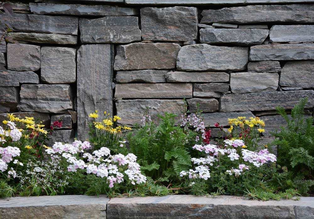 Custom Granite Wall with Flower Bed